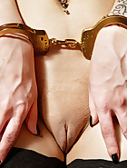 Kimberly in handcuffs